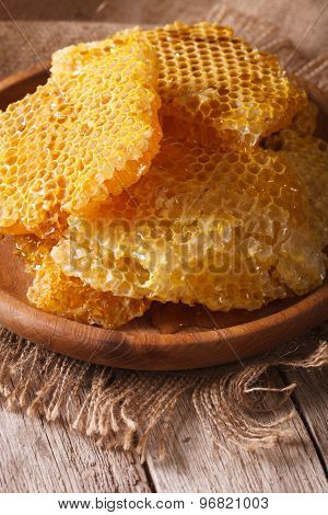 Fresh Honey Combs On A Wooden Plate Close-up. Vertical