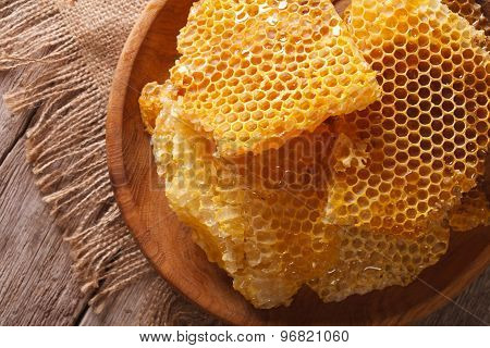 Honeycomb In The Wooden Plate Close-up. Horizontal Top View