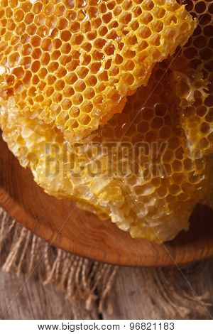 Honeycomb Macro On A Wooden Plate. Vertical Top View