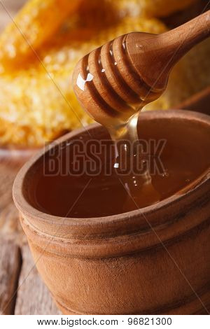 Honey Flowing Down From The Sticks Macro. Vertical