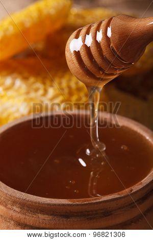 Liquid Flower Honey Dripping From A Stick Macro. Vertical