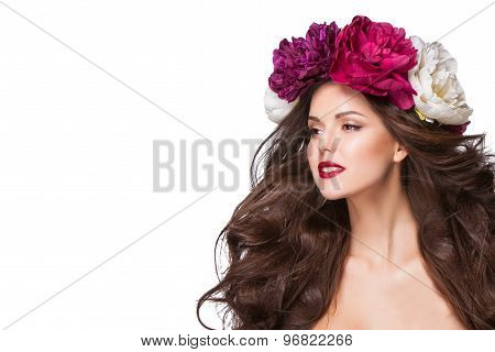 beautiful brunette young woman with wreath of peonies flowers studio shot
