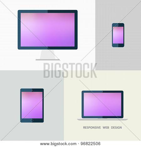 Responsive web design. Desktop monitor, laptop, tablet and smartphone. Blurred background.