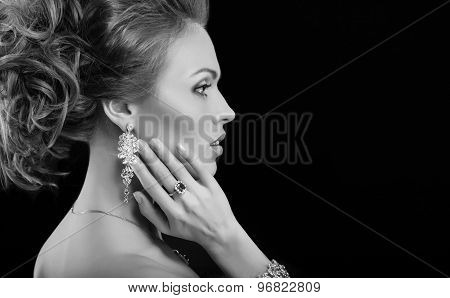 portrait of a beautiful brunette girl with luxury accessories. Fashion model. Black and white photo