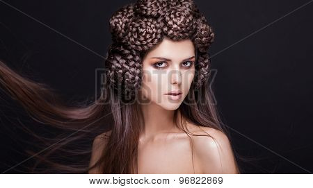 Portrait of beautiful fashion model with a creative pigtails hairstyling.