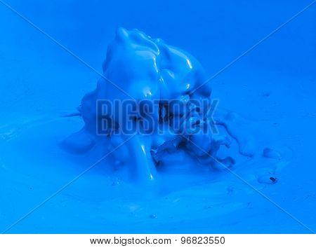 Vivid blue splash frozen high speed photo