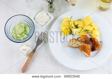 Braded Cauliflower On Table With White Cloth