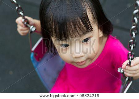 Asian Kid Swing At Park