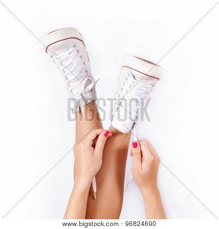Sneakers on women legs