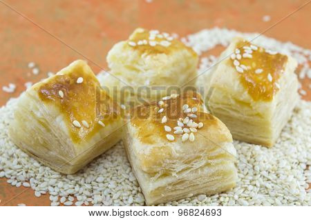 Puff Pastry With Sesame On Orange Background With Sesame Seeds