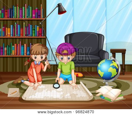 Boy and girl sitting on the floor in studying room looking in the map