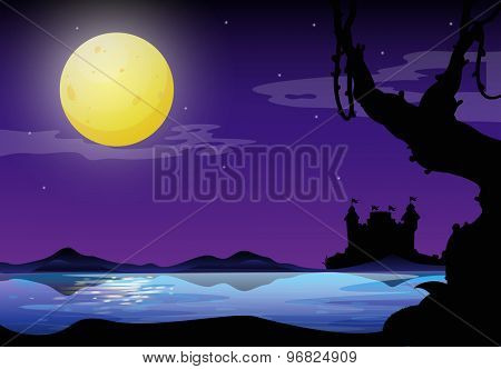Silhouette of a full moon night with purple sky and castel on the other side of the river