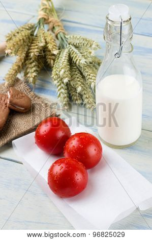 Three Red Tomatoes And Glass Of Milk