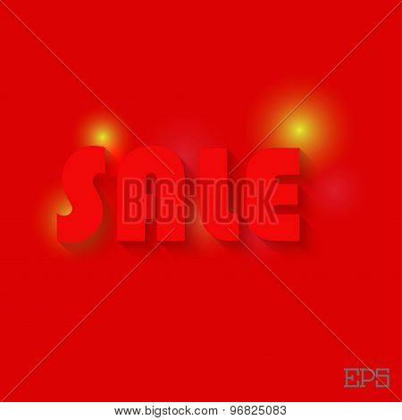 The inscription SALE on a red background paper