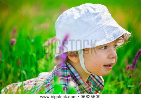 Baby Boy On A Meadow