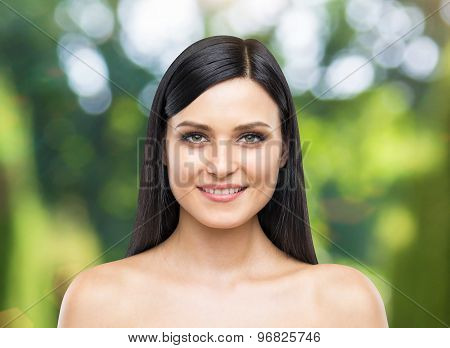 A Portrait Of A Smiling Attractive Lady. Tropical Landscape As A Background.