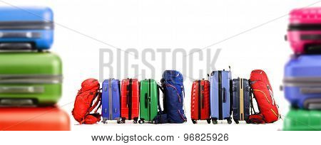 Suitcases And Backpacks Isolated On White Background
