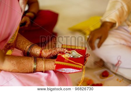 Indian Lady Offering Money And Red Envelope