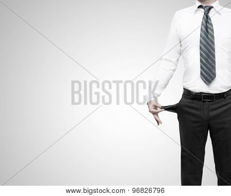 Businessman Standing With Pockets Turned Inside Out