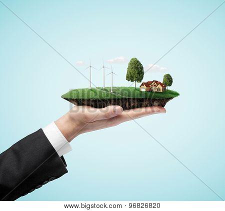 Businessman Hand Holding Landscape