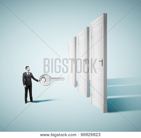Businesman Holding Big Key