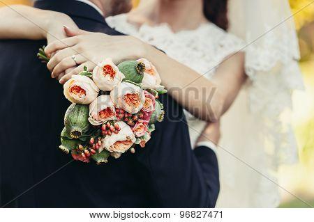 Bride Hug Groom With Wedding Bouquet