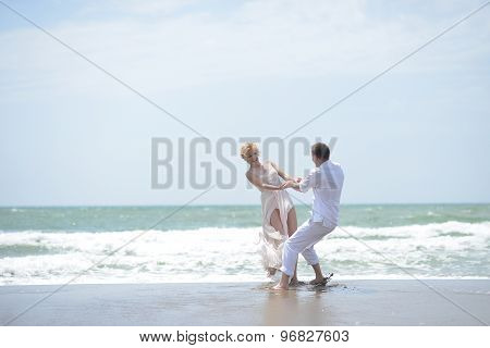 Attractive Wedding Couple On Beach