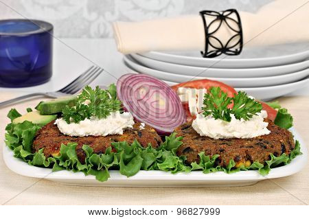 Black Bean Vegetarian Burgers With A Goat Cheese Topping.