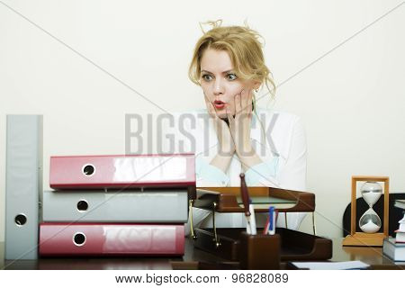 Overworked Woman At Office Table