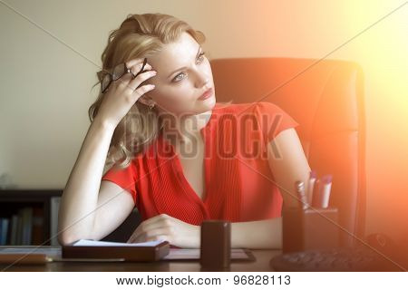Pensive Business Woman In Chair