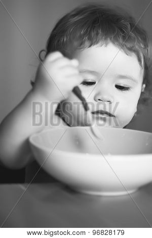 Portrait Of Baby Boy Eating