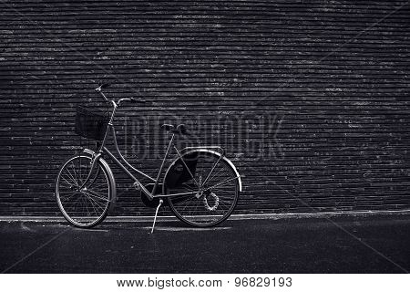 Classic Vintage Hipster Retro Bicycle Leaning Against The Street Wall