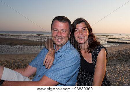 Summer scene of an happy middle aged couple in the beach