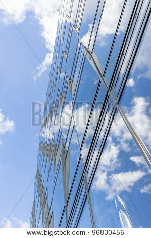 Sky And Clouds Mirroring In A Glass Facade