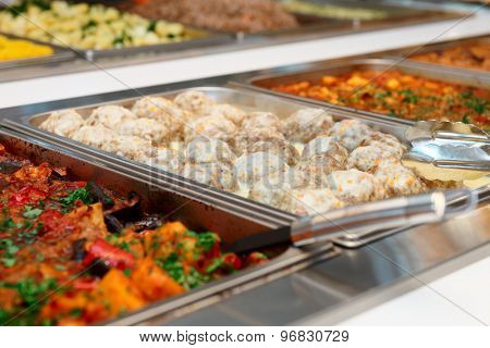 Meatballs and stewed vegetables in marmites