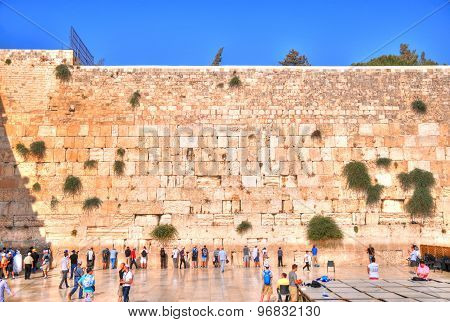 HDR (high dynamic range) image - People visiting and praying at the Western Wall in a clear blue sky