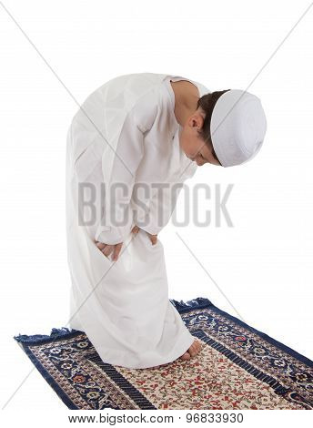 Muslim young boy praying