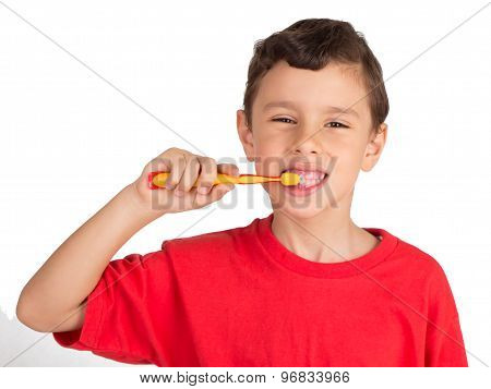 Young boy happily brushing his teethh