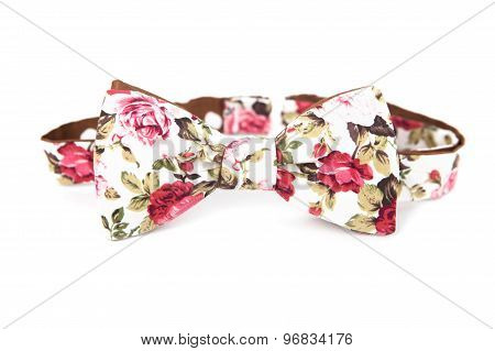 Bow tie with floral image on an isolated white background