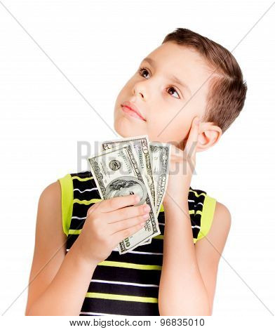Young boy looking up and thinking what to buy with his money