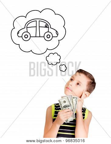 Young boy dreaming with a car to buy with his money