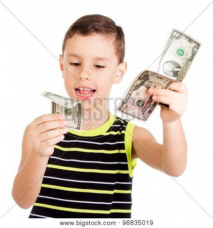 Young boy happily playing with dollars