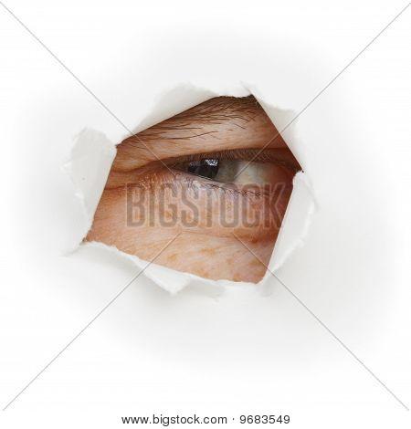 Squinting Eye Looks Through A Hole