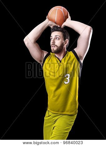 Basketball Player on a yellow uniform on black background
