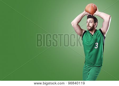 Basketball Player on a green uniform on green background