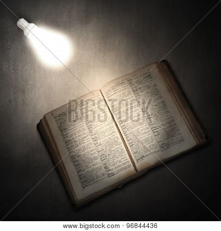 Book and light bulb