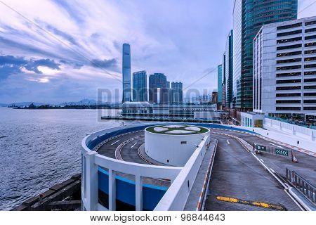 park lot and modern skyline at hong kong harbor