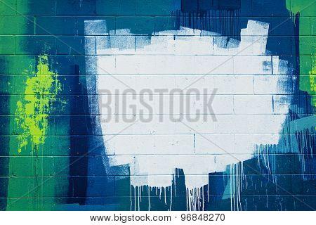 White paint stroke copyspace on a cement block wall. Urban Grunge