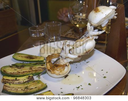 Skewers Of Grilled Cuttlefish With Zucchini And Polenta