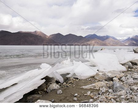 Ice Lake In Mountain Range And Rain Clouds Background,  Ladakh, India